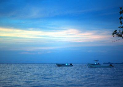Sunset with boats - Taveuni, Fiji