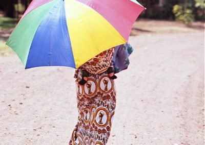 Woman with Coloured Umbrella - Tanzania