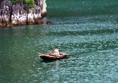 Young Fisherman in Halong Bay , Vietnam