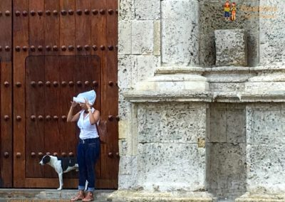Dog and girl under the rain - Cartagena, Colombia